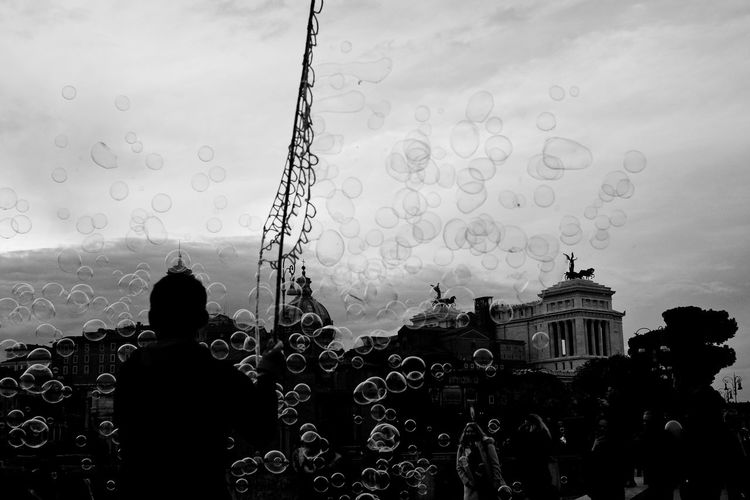Bubbles in Rome Bubbles Roma Rome Black Black And White Bubble Built Structure City Day Italy Street Photography Streetphotography Streetphotography_bw