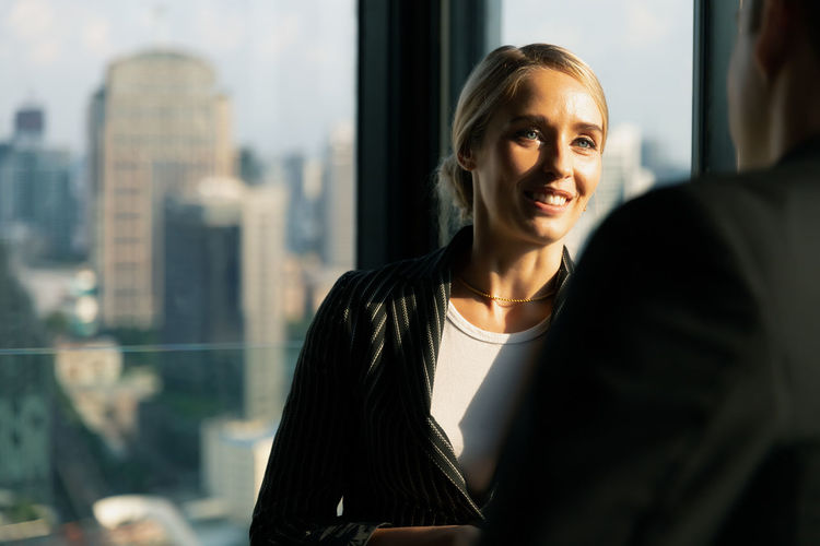 Businesswoman having discussion with colleague at office
