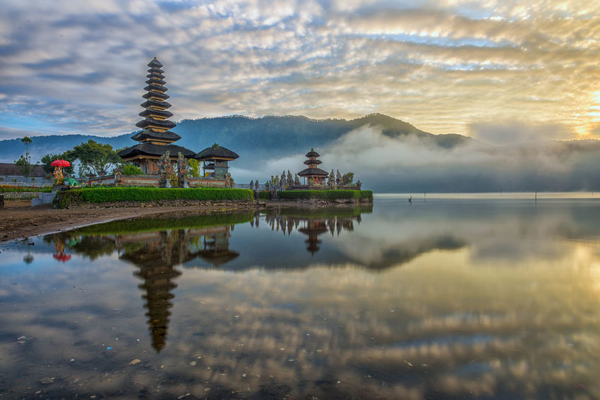 Sunrise at Pura Ulun Danu Bratan, a major Shivaite temple in Bali, Indonesia Architecture ASIA Bali Building Exterior Cloud - Sky Hindu Hindu Temple Hinduism House Of Worship INDONESIA Lake No People Outdoors Pura Ulun Danu Bratan Temple Reflection Religion Sky Sunrise Sunset Temple Tourist Tourist Attraction  Travel Travel Destinations Water