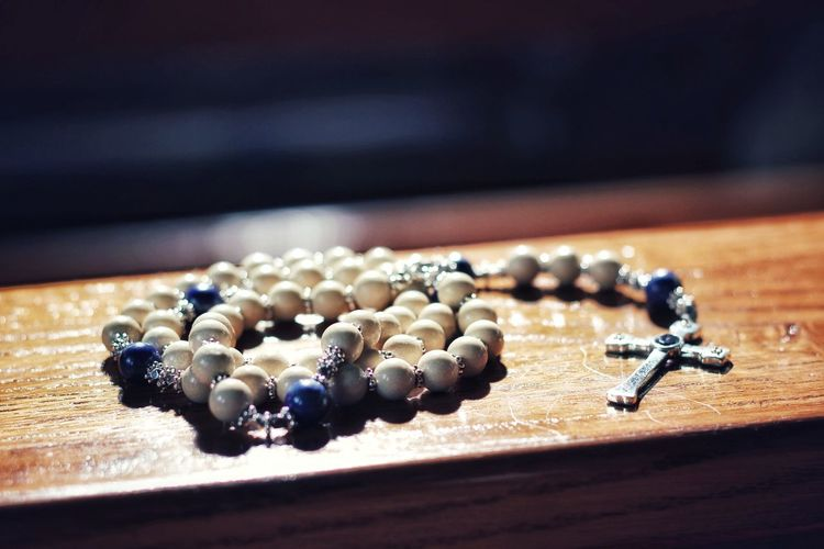 moment of peace Religion Christianity Christian Roman Catholic Cross Tranquility Peaceful Quiet Moments Moments Life Time To Reflect Prayer Meditation Temple Simple Life Rosary Beads Rosary Beads Rosarycollection Church Church Interior Wood Stone Lapis Lazuli Silver  No People Indoors  Luxury Close-up