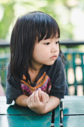 Bangs Casual Clothing Child Childhood Contemplation Cute Females Focus On Foreground Front View Girls Hair Hairstyle Headshot Innocence Leisure Activity Lifestyles Looking One Person Portrait Real People Women