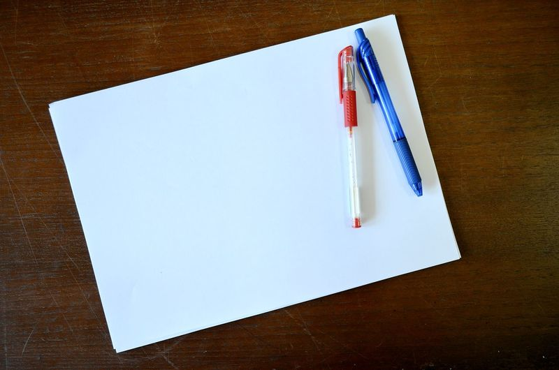 paper and pen, paper and pen put on the paper. ready to note. Class Room Backgrounds Blue Pen Book Close-up Day Desk Diary Directly Above Education High Angle View Indoors  Learning No People Note Note Pad Paper Pen Pencil Red Pen Study Table Teacher Wood - Material