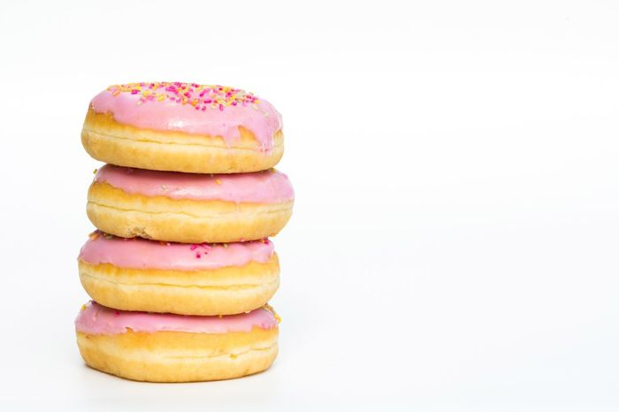 A stack of donuts with pink icing and sprinkles on an isolated white background. Donuts Donuts🍩 Doughnuts Doughnut Pink Pink Color Icing Iced Sprinkles Hundreds And Thousands Unhealthy Eating Fattening Sugar Treats Food Glazing Foodporn Sweet White Background Sweet Food Foodphotography Treat Food Porn Stack Pile