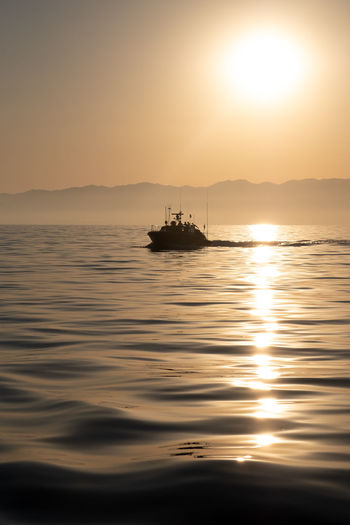 Motorboat Nautical Vessel No People Outdoors Reflection Scenics - Nature Sea Sky Sunlight Sunset Tranquility Water