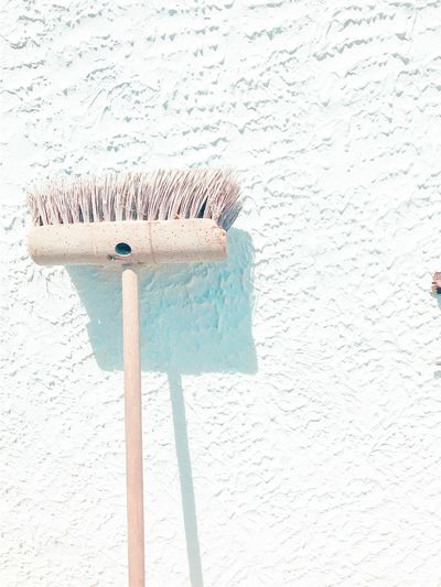 EyeEm Selects Simplicity Broom Cleaning Equipment Sweeping No People Close-up Exterior Wall Outdoors Brush Cleaning EyeEm Gallery hard bristles Brush Against White Wall With Copy Space