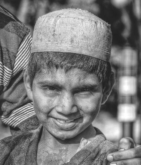 Portrait of poor smiling boy