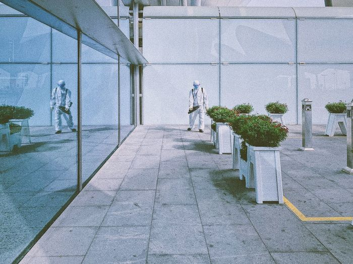 Empty footpath by building in city