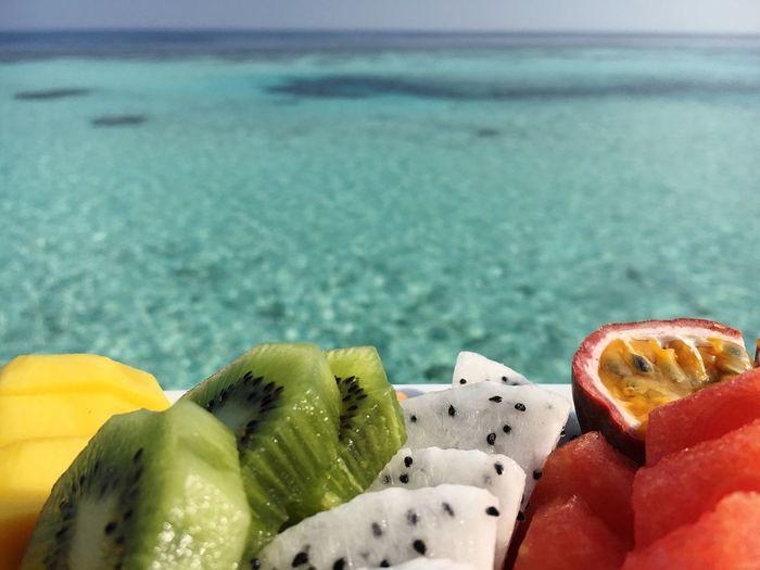 Close-up of fruit at beach
