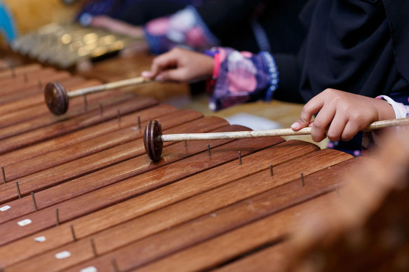 Close-up of hands playing the xylophone