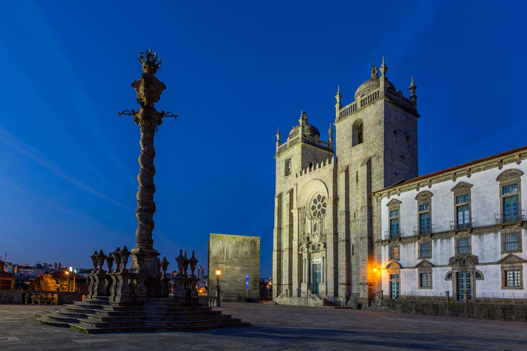 Sé do Porto (Cathedral) at Porto, Portugal Architecture Built Structure Sky Building Exterior Religion Building Spirituality Belief Place Of Worship Blue The Past History Sculpture Nature City Travel No People Architectural Column Porto Portugal Europe Cathedral Sé Do Porto Tourism Tourist Attraction