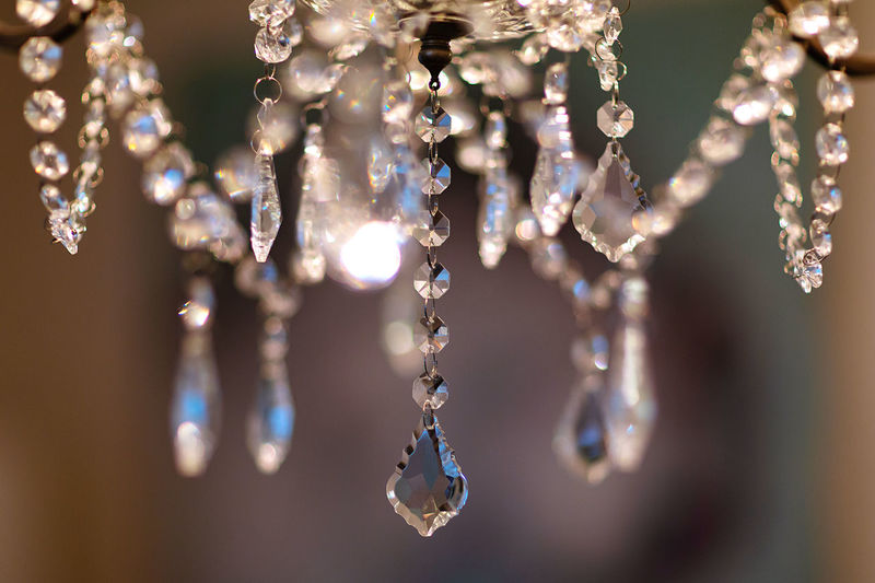 Close-up of chandelier hanging on ceiling
