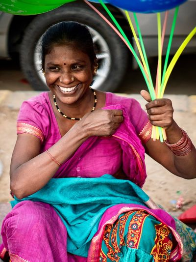 New Delhi India Streetphotography Street Photography Street Portrait Photography Portrait Of A Woman Portraidmood Portraits Portrait Sitting Black Hair Real People Women One Person Smiling Looking At Camera Portrait Sari Only Women Multi Colored Happiness One Woman Only Working Adult Close-up Human Hand People Day Outdoors EyeEmNewHere An Eye For Travel