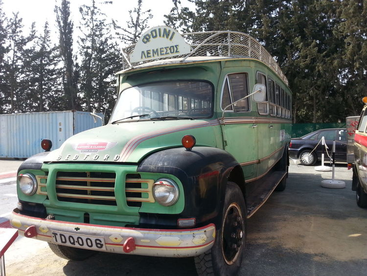 Antique Bus Antique Car Bus City City Life City Street Day Gr Green And Black Land Vehicle Mode Of Transport No People Old Old Buildings Old Car Outdoors Parked Parking Road Sky Stationary Transportation Tree Truck Vintage Car