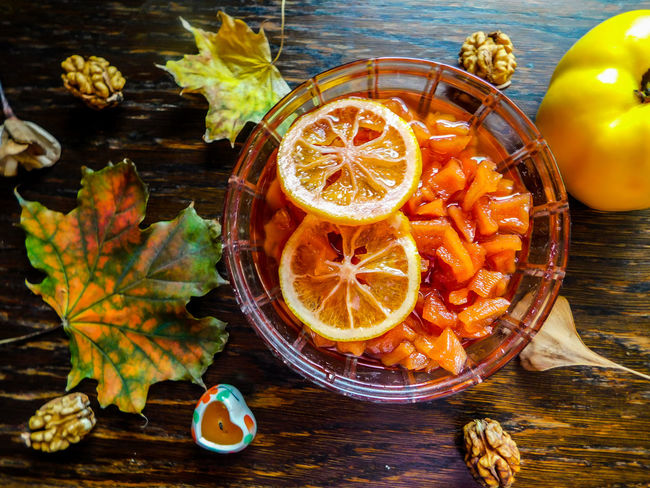 Autumn ideal Autumn Desk Nuts Close-up Decoration Decorative Food Food And Drink Freshness Fruit Healthy Eating High Angle View Ideal Leaf Leaves No People Nut - Food Orange Color Quince Sweet Table Wooden Yellow