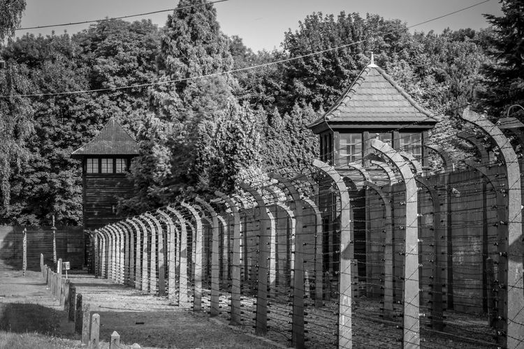Auschwitz I Stammlager Auschwitz Birkenau Auschwitz  Architecture Built Structure Building Exterior Tree Plant Building Day Nature No People Outdoors Boundary Sky Fence Barrier Religion Place Of Worship Spirituality Belief Growth The Past Architecture Tree History House