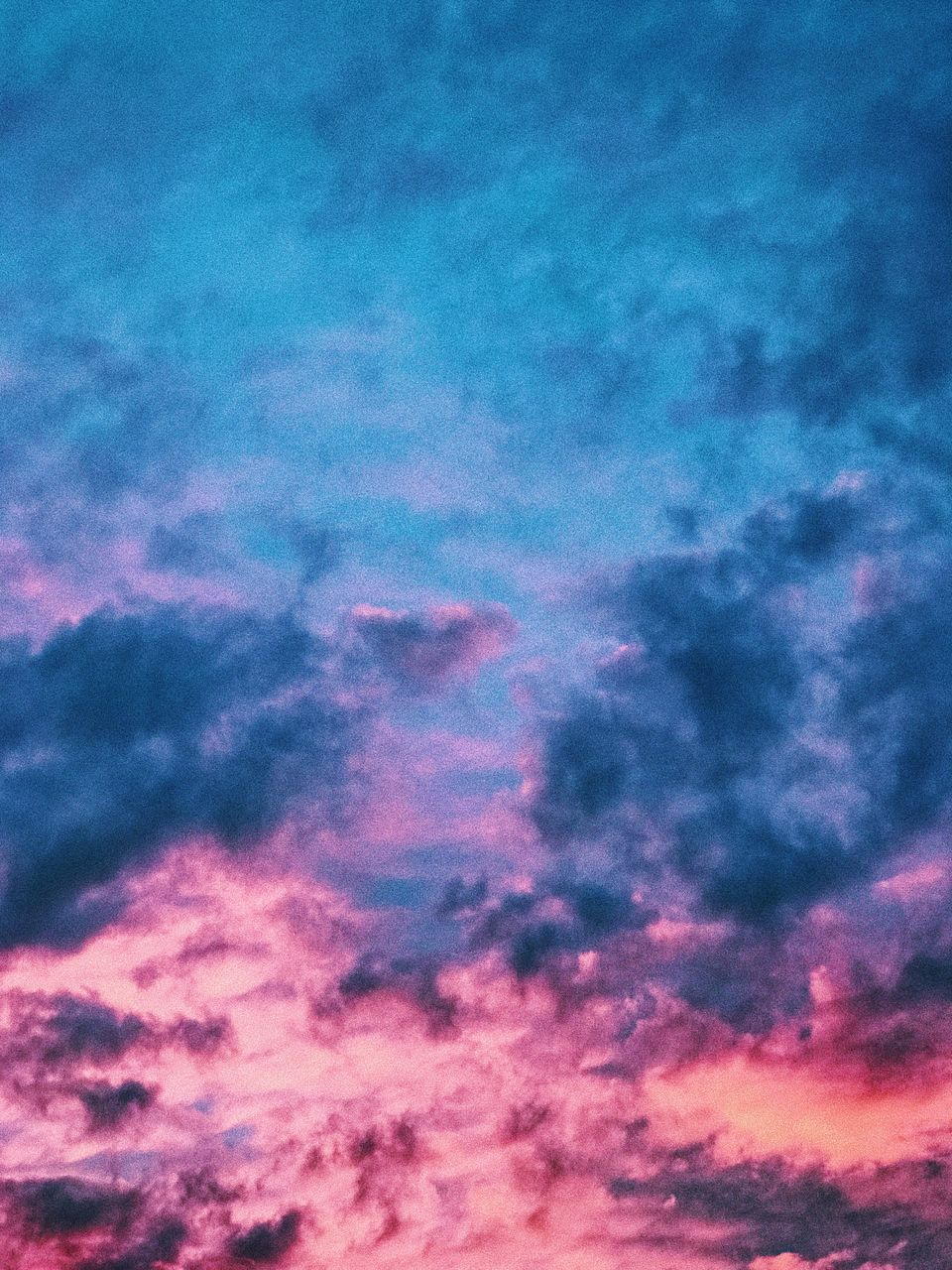 sky, cloud - sky, backgrounds, beauty in nature, abstract, sunset, majestic, sky only, dramatic sky, nature, low angle view, full frame, scenics, tranquility, cloudscape, multi colored, no people, tranquil scene, pink color, outdoors, blue, space, day, astronomy