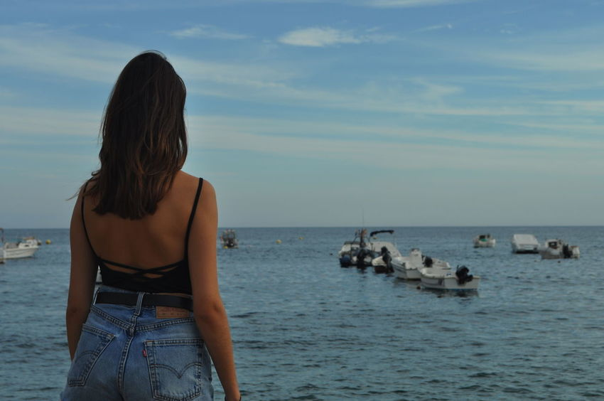 Person Water Sea Rear View Standing Leisure Activity Vacations Lifestyles Long Hair Weekend Activities Horizon Over Water Sky Scenics Tourism Casual Clothing Enjoyment Relaxation Granada Calahonda Beach Friends Model Adapted To The City