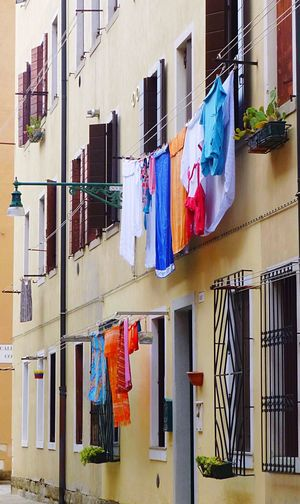 Colorful laundry Drying Clothing Clothesline Hanging Laundry Multi Colored Building Exterior Window Balcony Architecture Built Structure Clothes Travel Destinations Historical Building Old Buildings Old Town Washing Variation Clothespin Chores