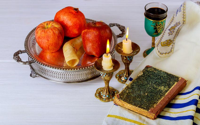 Jewesh holiday shofar, torah book, honey, apple and pomegranate rosh hashanah traditional holiday symbols. Jewish Torah Torah Scrolls Yom Kippur Celebration Event Jewish Holiday Jewish New Year Kosher Food Rosh Hashanah Shana Tova Shofar Tallit
