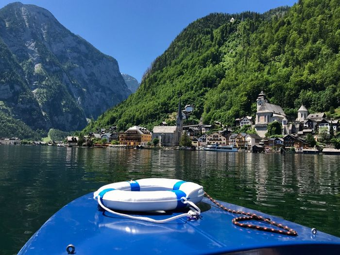 Boats in lake against mountains