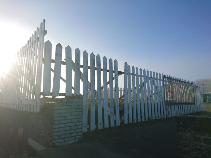 Fence against clear sky