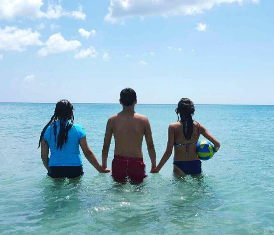 Feel The Journey Ocean Beautiful Sibling Love Volleyball Sunny Day Blue Three Walking Florida Life Holding Hands Horizon Showcase June Fine Art Photography 43 Golden Moments Holdinghands Happiness Florida Lifeisgood Beachphotography Beautiful Day