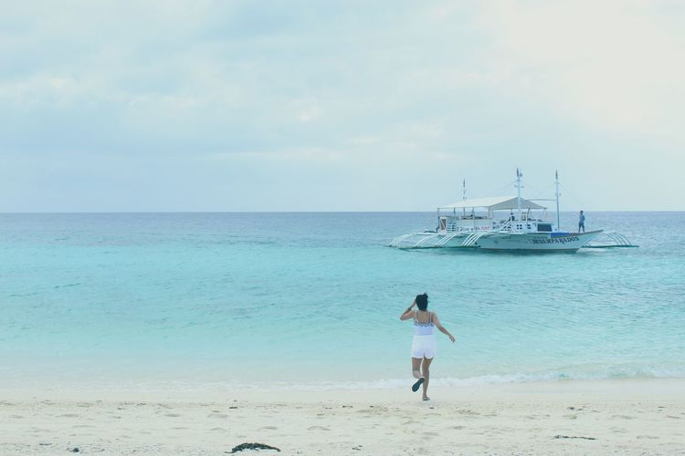 Having to run just to have a candid picture. 😅 Sea Beach Water Horizon Over Water Nautical Vessel Outdoors Vacations Standing Tranquility Rear View Nature Day Full Length Sand Beauty In Nature Cloud - Sky One Person People Sailing Ship Sky EyeemPhilippines Blues Getaways Remote Sommergefühle