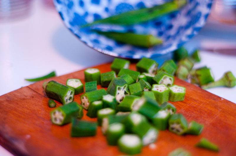Close-up of chopped okras on cutting board