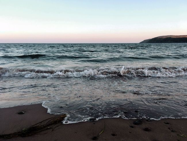 Waves after sunset on a Welsh beach Water Sky Sea Beach Beauty In Nature Land Scenics - Nature Tranquility Tranquil Scene Nature Horizon Over Water No People Wave Motion Clear Sky Idyllic Copy Space Outdoors Sunset