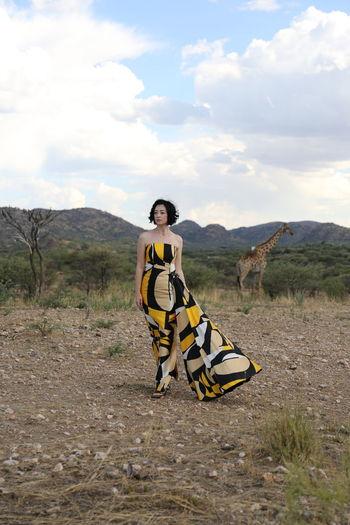 Full length of woman on landscape against sky