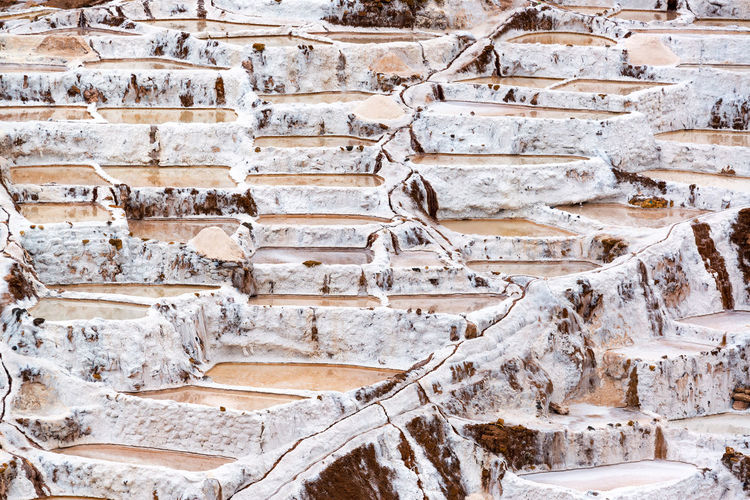 Salt production in the town of Maras in the Sacred Valley near Cusco, Peru Andes Culture Cusco Cusco, Peru Destination Farm Food Inca Maras Maras - Peru Mine Mountains Outdoors Pans Peru Rural Sacred Valley Sacred Valley - Peru Salinas Salt Saltworks Tourist Travel Water White