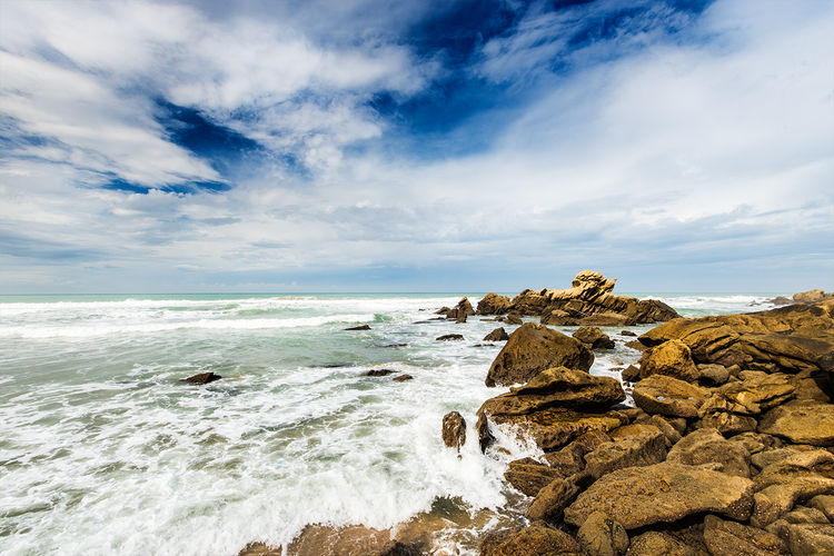 Waves crash along the coast of Morocco. Beauty In Nature Blue Cloud Cloud - Sky Cloudy Coastline Day Horizon Over Water Idyllic Nature No People Non-urban Scene Outdoors Remote Rock Rock - Object Rock Formation Scenics Sea Shore Sky Tranquil Scene Tranquility Water Wave