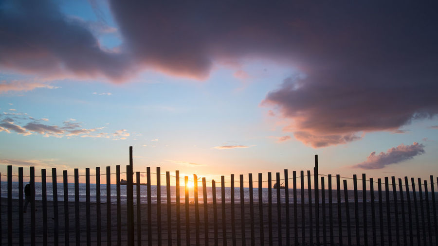 Sky Cloud - Sky Sunset Nature Fence No People Boundary Dramatic Sky Sun Pacific Ocean Beach Wooden Fence California Outdoors Cloudy Purple Clouds Orange Color