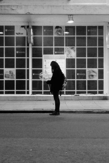 Full length rear view of woman walking in building