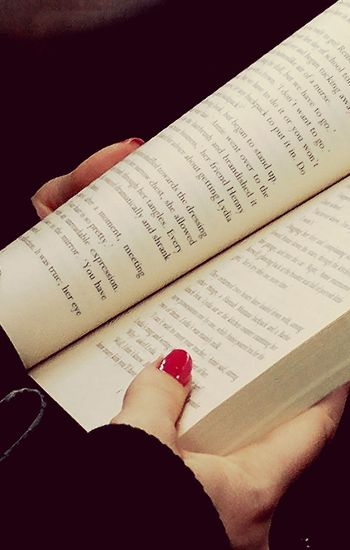Reading on the bus Human Hand Nail Polish Red Paper Arts Culture And Entertainment High Angle View Text Low Section Communication Close-up Knowledge Page Book