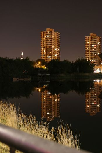 Canada Water London Shard London Architecture Building Building Exterior Built Structure City Illuminated Lake Nature Night No People Outdoors Plant Reflection Residential District Sky Tree Water Waterfront