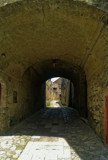 Old village. Arch Architecture Archway Building Building Exterior Built Structure Cityscape Cityscapes Damaged Eye4photography  Historic History Indoors  Old Old Ruin Stone Wall Streetphotography The Past The Way Forward Tunnel Village Wall - Building Feature Weathered
