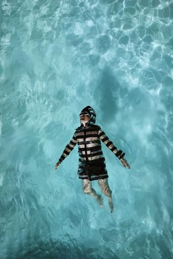 Placenta of thoughts. Water Pool Pool Water One Person One Man Only Man Men Stripes Swimming Swimming Pool Blue Looking Up Coat