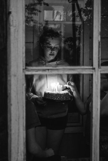 Portrait of young woman holding birthday cake