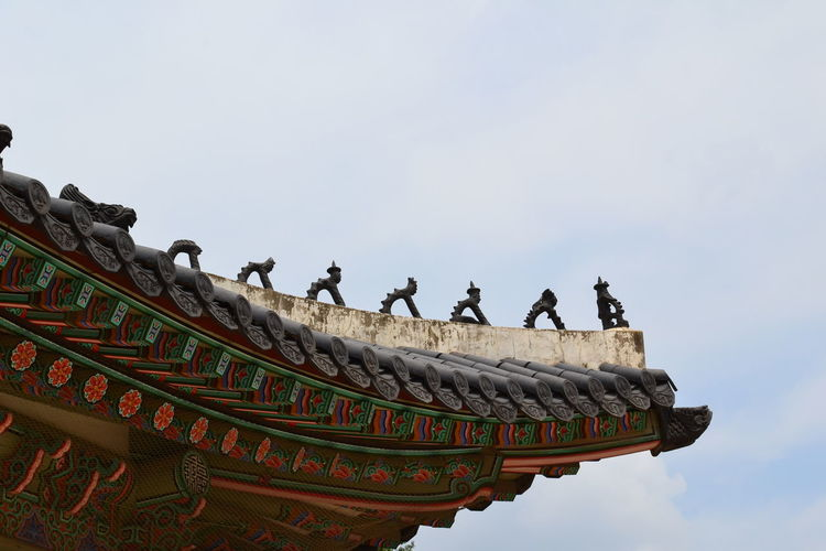 Low angle view of statue on roof