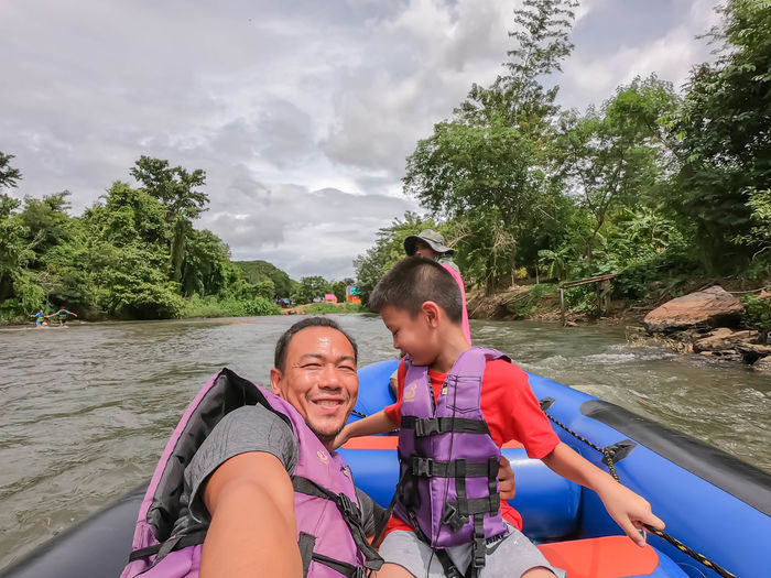 Tourists on the inflatable boat floating on the water in the river The flow of Kaeng Krachan Dam at Phetchaburi in Thailand. June 10, 2019 Activity Adventure Belt  Boat Clothes Clothing Cruise Dam Equipment Experience Float Flow  Fun Green Happy Jacket Kaeng Krachan Lake Leisure Mountain Nature Outdoor Phetchaburi Protect Protection Protective Raft Relax Rescue River Riverside Rubber Safe Safety Security Sightseeing Sport Summer Swim Thailand Tour Tourism Tourist Travel Tree Trip Vacation Water Wear Wildlife