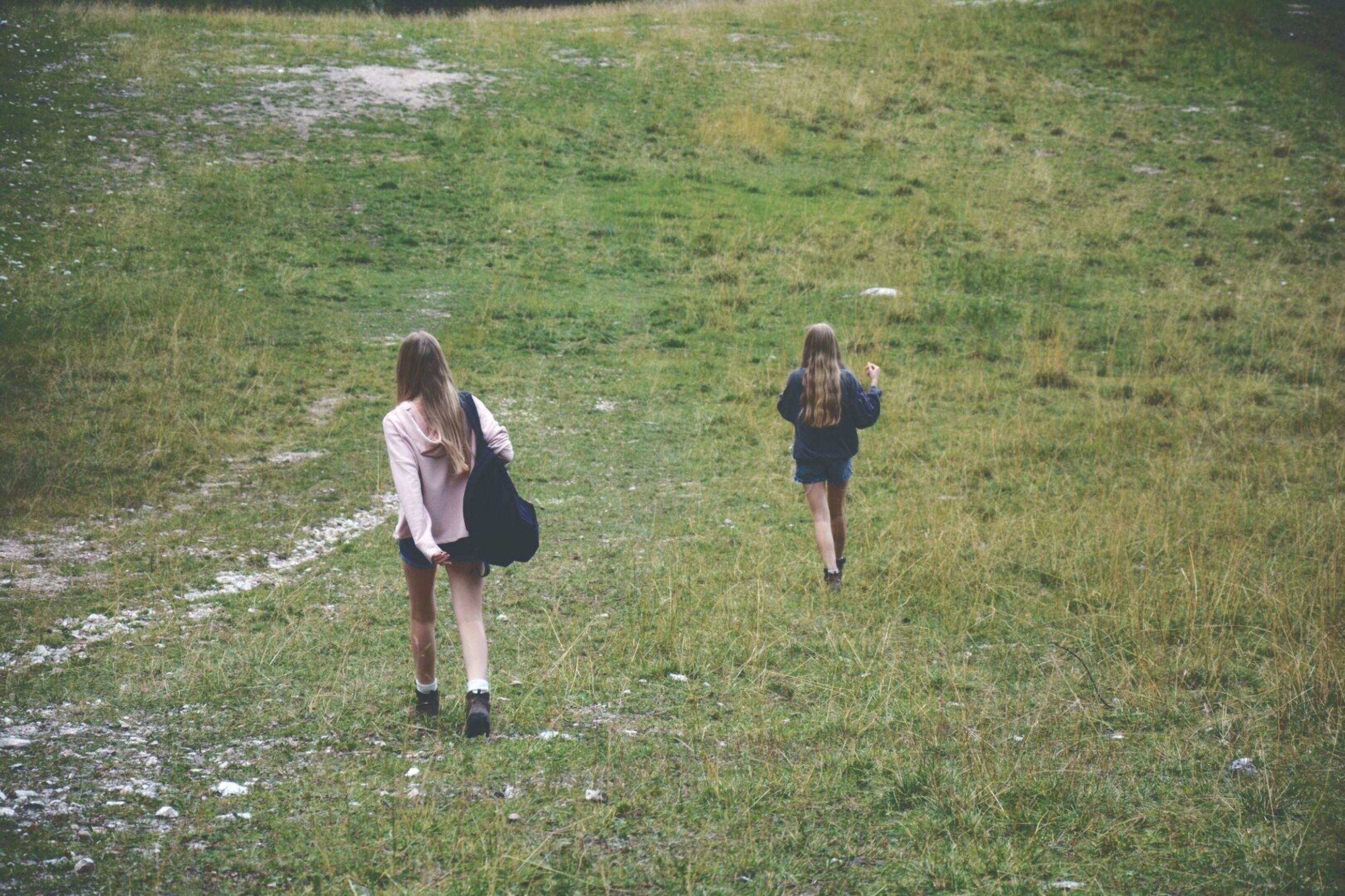 grass, landscape, walking, rear view, field, two people, standing, real people, full length, hiking, togetherness, nature, friendship, outdoors, day, people, adult