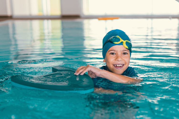 Boy on Swimming Class Swimming Children Swimming Lessons Swimming Class Child Swim Child Swimming Lessons Swimming Pool Swimming Instructor Pool Class Boy Water Fun Activity Cute Blue Childhood Lesson Sport Male Happy Kid Learning People Swimwear Swimming Cap Swimmer Indoors  Physical Activity Young Play Lifestyle Teaching Leasure Photography Caucasian Healthy Action Cheerful Recreational  Recreation  Playful Boys Water Sport Exercise Exercising Man Female Swimming Board Swimming Goggles Smiling Training