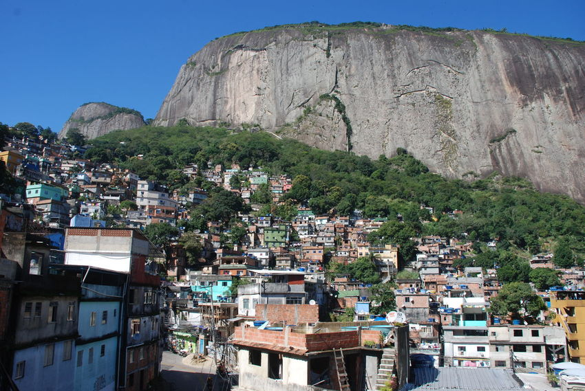 Rocinha Favela, Rio de Janeiro Favela Houses Favela Rocinha Rio De Janeiro Rocinha Building Exterior Built Structure Clear Sky Crowded Dwellings Favela Homes Mountain No People Outdoors Overcrowded Poverty Rio De Janeiro, Brazil Rocinha Slum