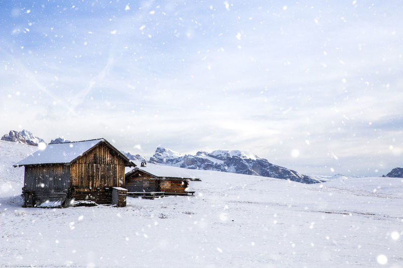 Scenic view of snow covered field against mountains