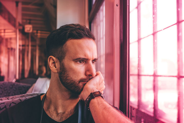 Beard Beautiful Colors Concentrated Concentration Eyes Future Hand Handsome Hipster Man Masculine Millennial Pink Model Pattern Pink Color Portrait Real People Serious Subway Thinking Train Trendy Window Young Adult