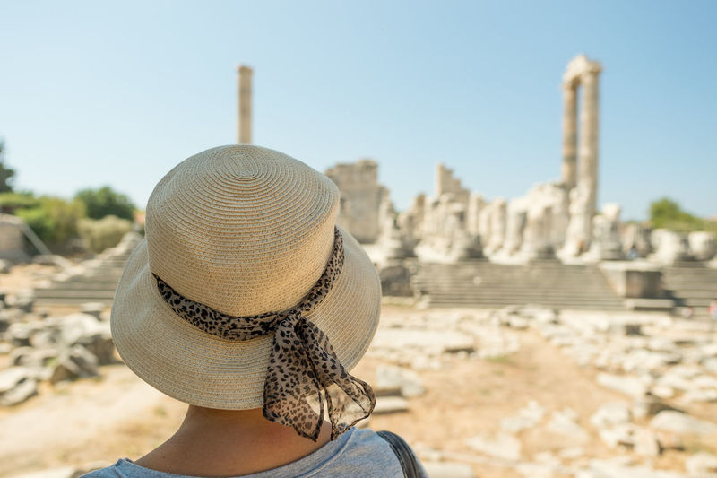 Rear view of woman wearing hat at temple of apollo