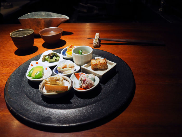 Close-Up Of Japanese Food Served On Wooden Table