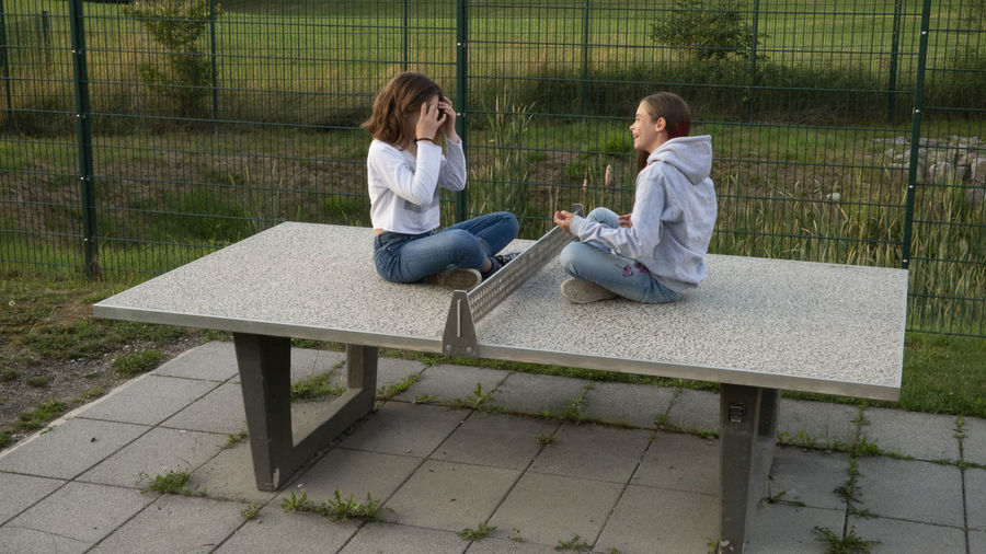 Girls on the table dance gymnastic gym fun first eyeem Photo Adult Bench Casual Clothing Couple - Relationship Day Family Females First Eyeem Photo Full Length Men Nature Outdoors People Plant Seat Sitting Togetherness Two People Women Young Adult Young Men Young Women