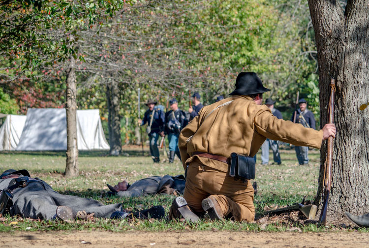 oct 8, 4th Annual Mooresville Civil War Days , South Haven, Michigan; a southern soldier reaches for his weopon as union soldiers advance during a civil war reenactment Acting Actors Camping Civil War Event Fight Michigan, USA Nature Soldiers USA Uniforms Union Armed Forces Editorial  Guns History Men Military North Vs South Outdoors People Real People Reenactment Weapon Weopons A New Perspective On Life